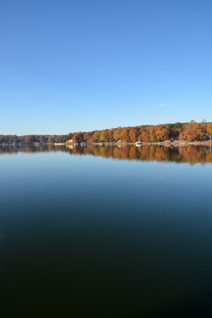 Fall color Lake Norman reflections | ©homeiswheretheboatis.net #fall #autumn #lake