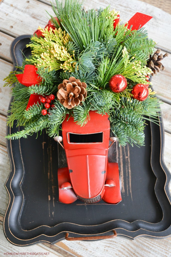 Christmas Truck Centerpiece with greenery | ©homeiswheretheboatis.net #christmas #truck #centerpiece