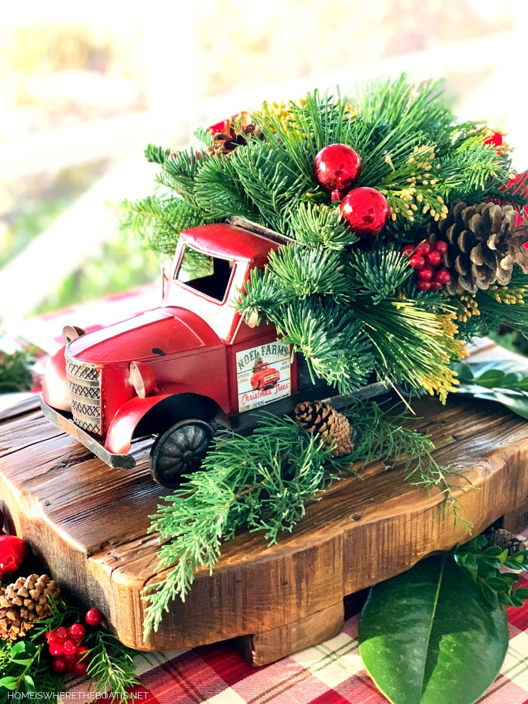 Noel Farms Christmas Truck Centerpiece with greenery | ©homeiswheretheboatis.net #christmas #truck #centerpiece #tablescape
