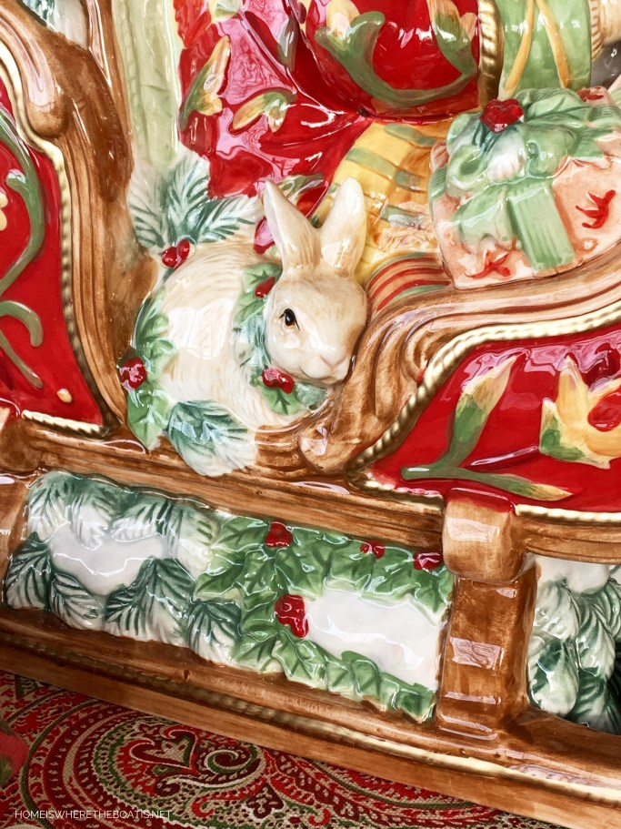 Bunny in Santa's sleigh Christmas Table | ©homeiswheretheboatis.net #Christmas #tablescapes #redandgreen