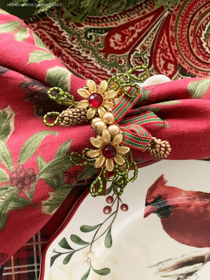 Beaded napkin rings with holly berry napkins | ©homeiswheretheboatis.net #Christmas #tablescapes
