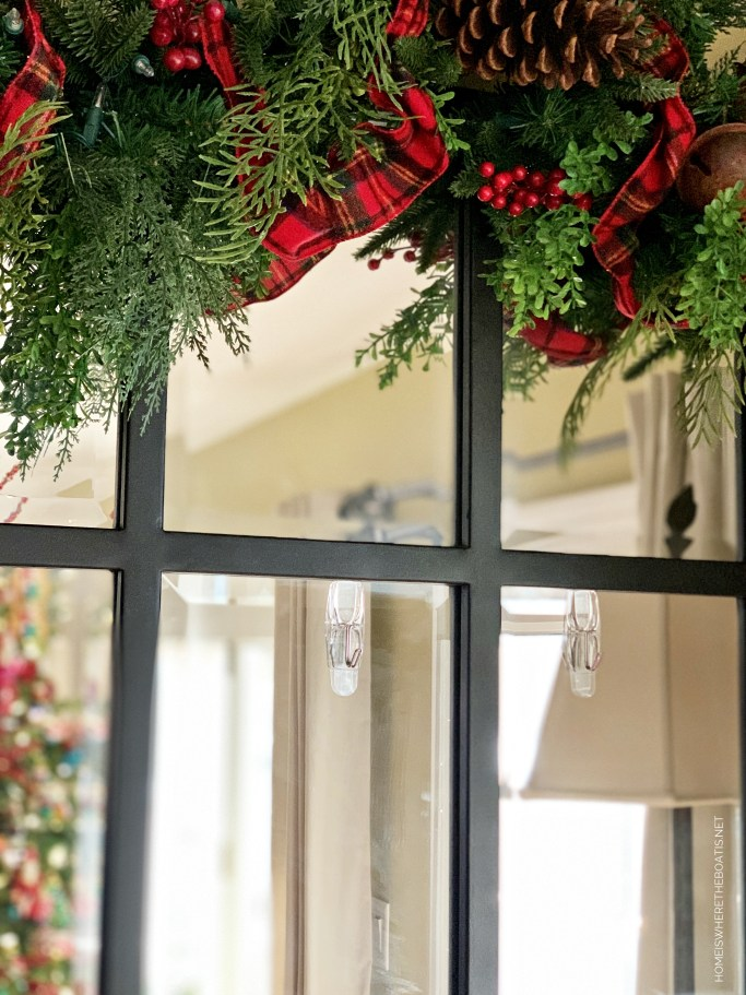 Command Hooks to hang Christmas wreath on mirror | ©homeiswheretheboatis.net #christmas #greenery #tartan
