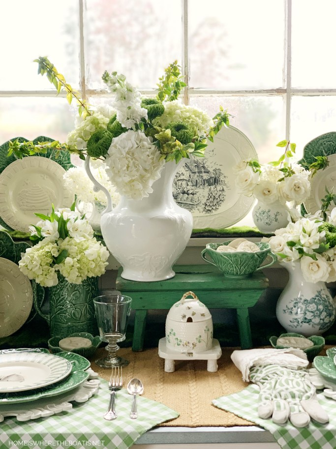 Spring green, flowers and nod to St. Patrick's Day in Potting Shed | ©homeiswheretheboatis.net #flowers #green #shed #stpatricksday #bees
