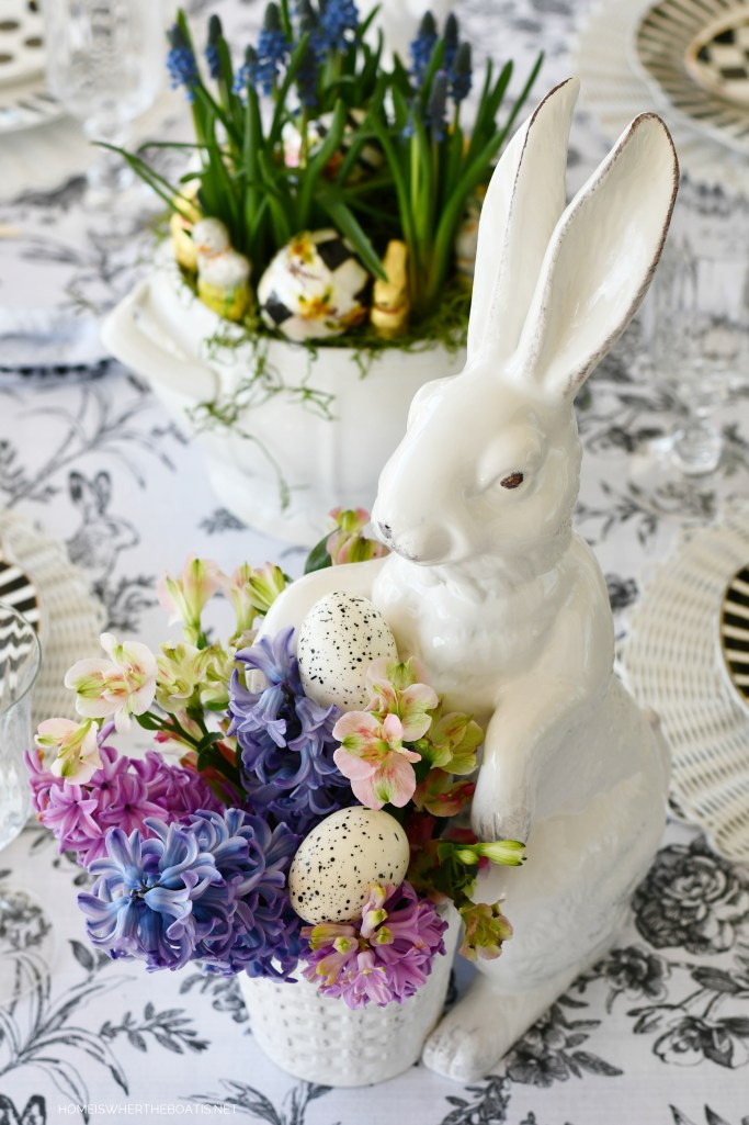 Black and White Easter Table with bunnies and eggs | ©homeiswheretheboatis.net #easter #tablescapes