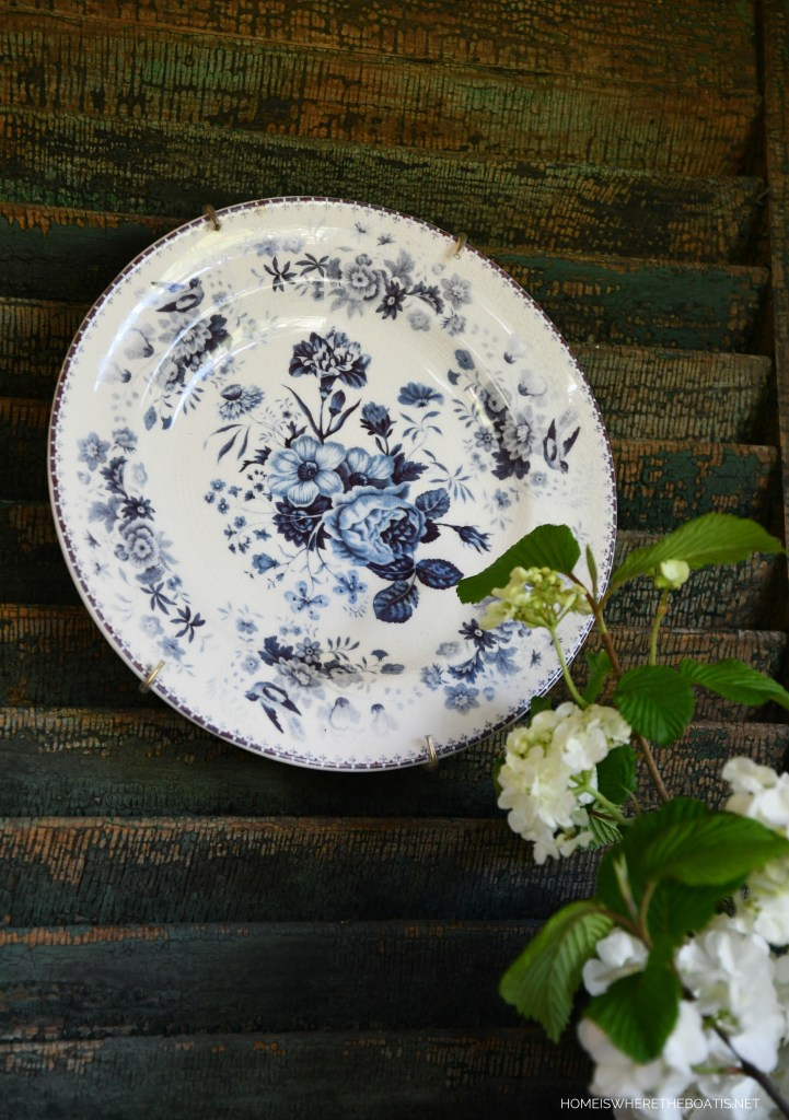 Blue and white floral plate on shutter | ©homeiswheretheboatis.net