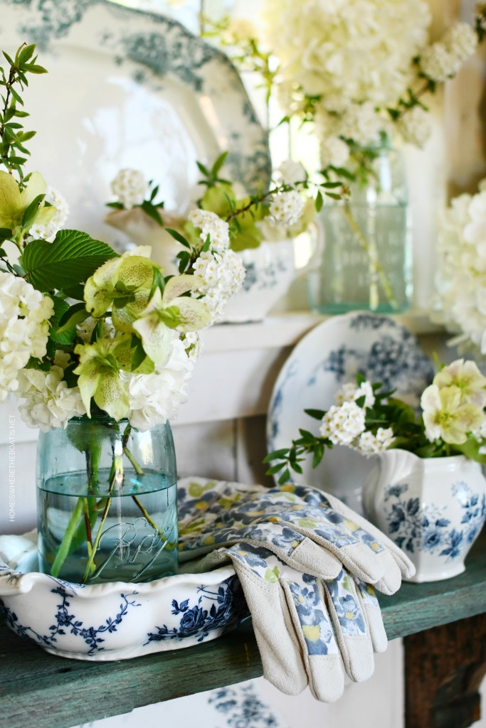 White spring blooms, mason jars and blue and white transferware | ©homeiswheretheboatis.net #flowers #spring #masonjars