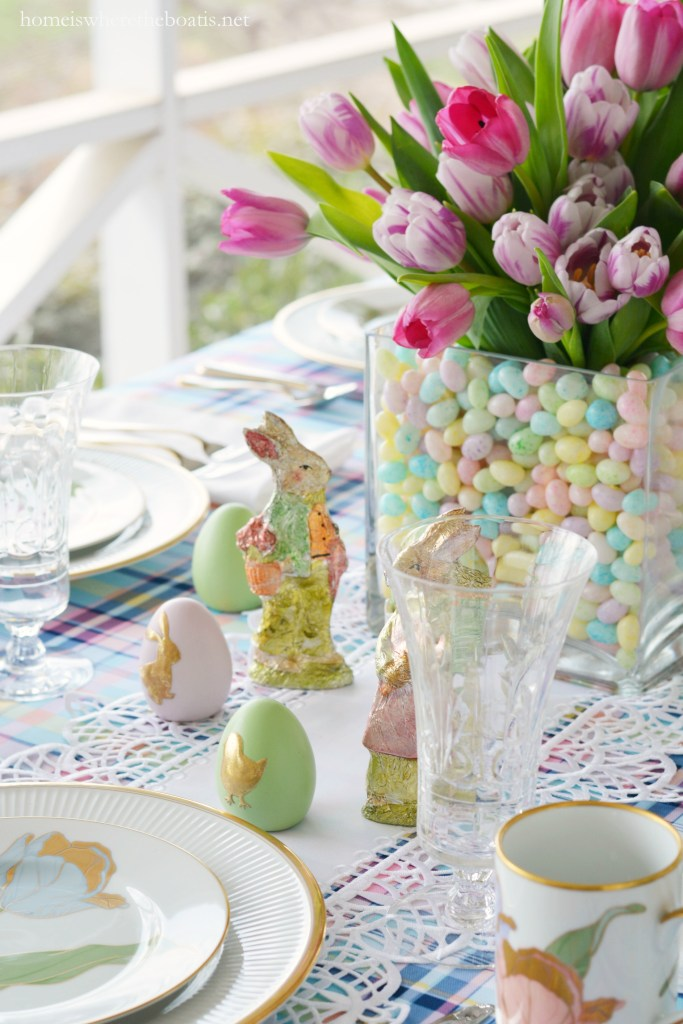 Easter table with bunnies, eggs, and tulips in jelly bean vase centerpiece! | homeiswheretheboatis.net #tablescapes #easter #tulips #spring