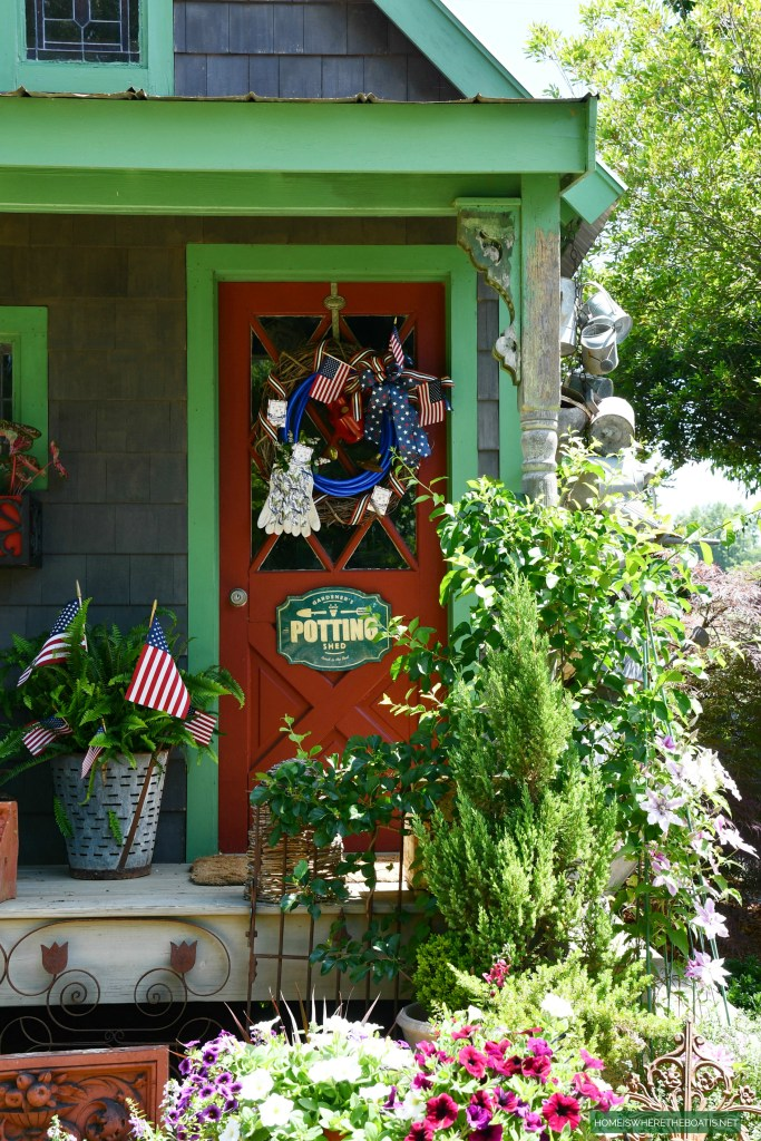 Patriotic Wreath using a garden hose for the Potting Shed | ©homeiswheretheboatis.net #patriotic #wreath #DIY
