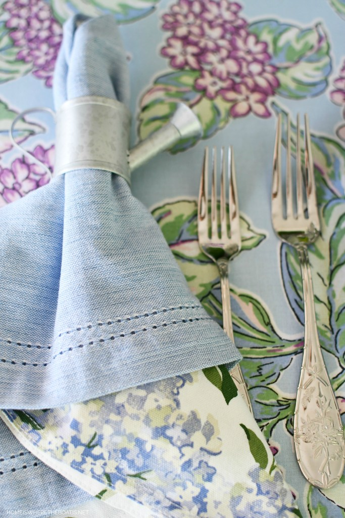 Garden table with watering can napkin ring | ©homeiswheretheboatis.net #flowers #tablescapes
