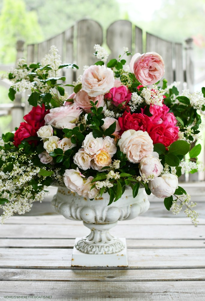 Flower arrangement in urn with garden roses | ©homeiswheretheboatis.net #flowers #roses