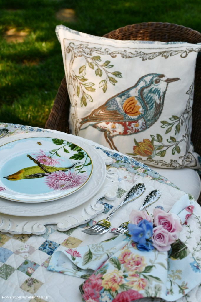 Bird pillow and salad plate | ©homeiswheretheboatis.net #spring #alfresco #tablescapes