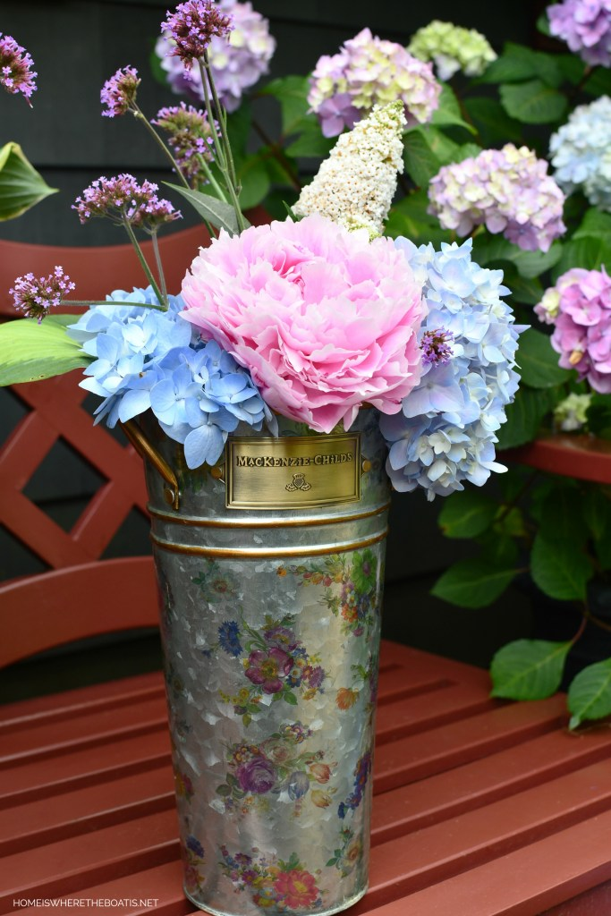 MacKenzie-Childs Flower Market Bucket of garden blooms by the Potting Shed | ©homeiswheretheboatis.net #flowers #garden #peony #hydrangeas