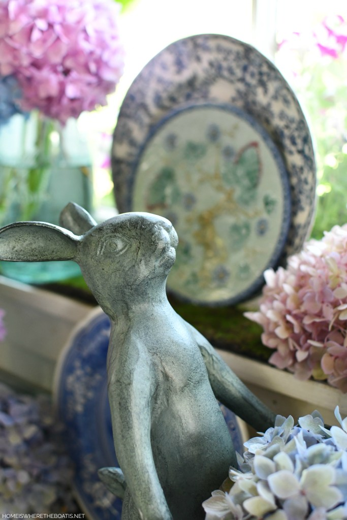 Gardener Bunnies with basket of hydrangeas in Potting Shed | ©homeiswheretheboatis.net #hydrangeas #tablescapes
