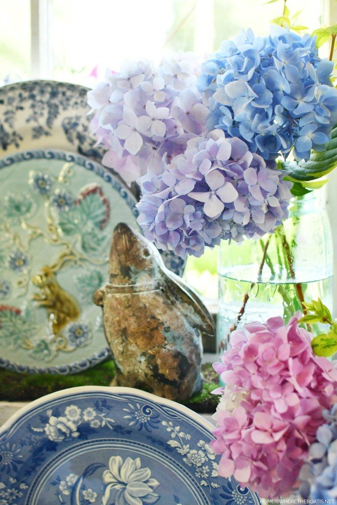 Mason jars of hydrangeas and bunnies in Potting Shed | ©homeiswheretheboatis.net #hydrangeas