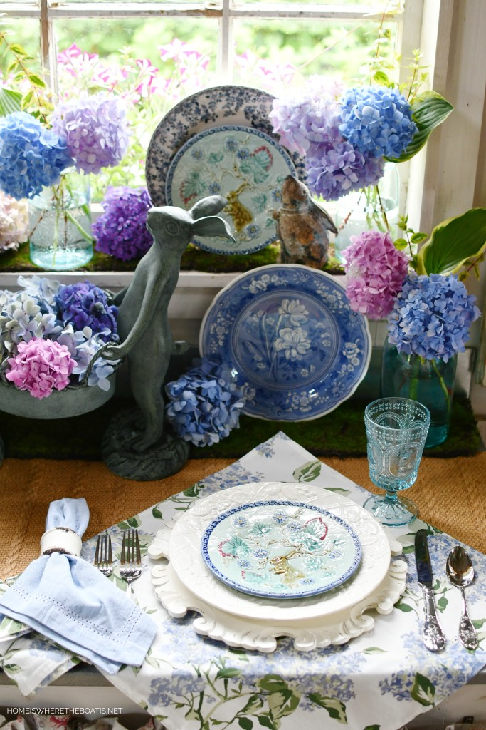 Bunnies and hydrangeas vignette in Potting Shed | ©homeiswheretheboatis.net #hydrangeas #tablescapes