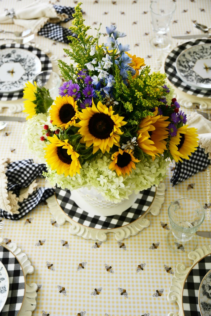 Bee Tablescape with Sunflowers and Hydrangeas Flower Arrangement | ©homeiswheretheboatis.net #tablescapes #summer #bees