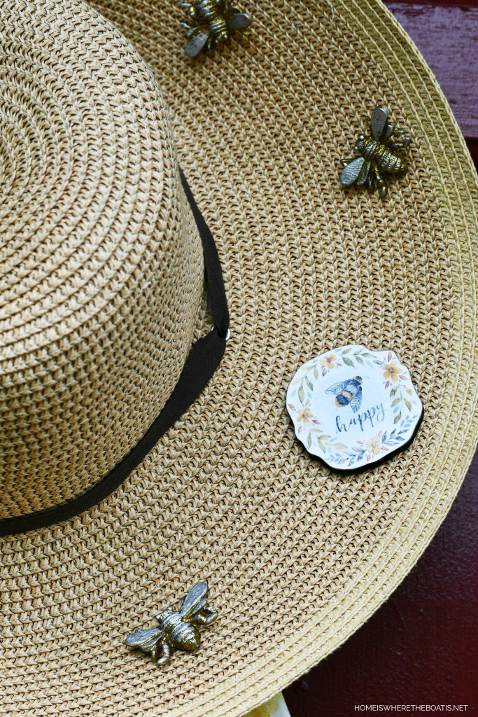 Straw hat with bees door decor for Potting Shed | ©homeiswheretheboatis.net #bees #flowers #garden #shed