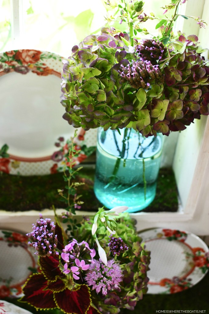 Ball jar garden bouquets and vignette in Potting Shed | ©homeiswheretheboatis.net #tablescapes #flowers #masonjars