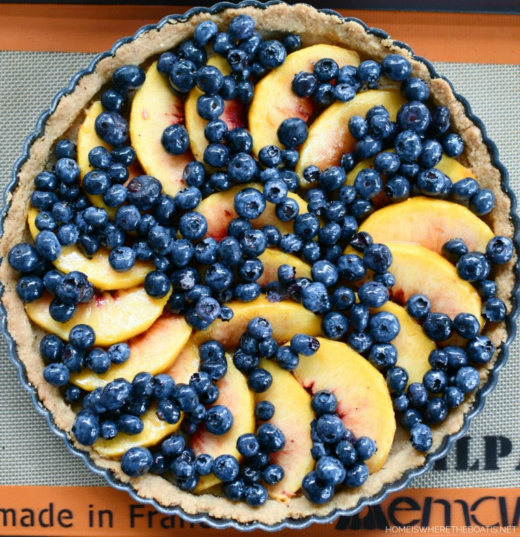 Peach-Blueberry Crumble Tart with Pecan Shortbread Cookie Crust | ©homeiswheretheboatis.net #peaches #recipes #tart #easy #summer #dessert
