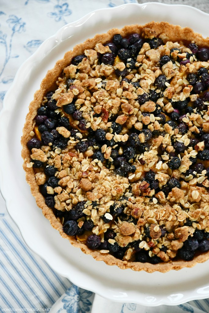 Peach-Blueberry Crumble Tart with Pecan Shortbread Cookie Crust   ©homeiswheretheboatis.net #peaches #recipes #tart #easy #summer #dessert