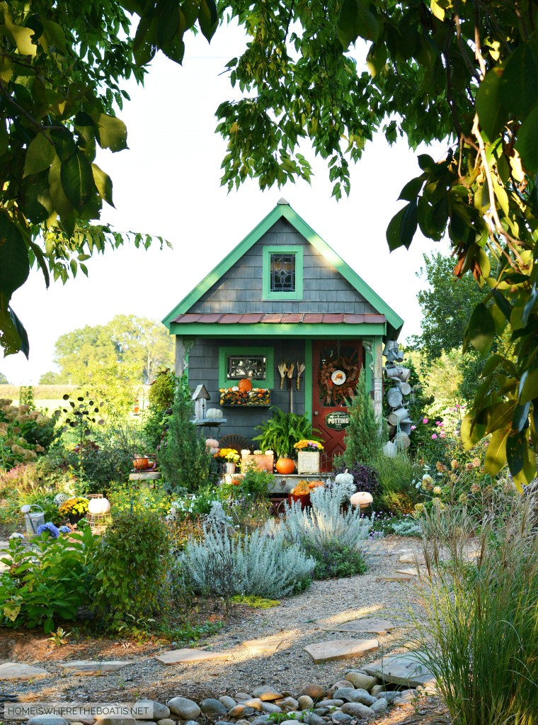 Hello Autumn Potting Shed | ©homeiswheretheboatis.net #fall #shed #pumpkins #mums