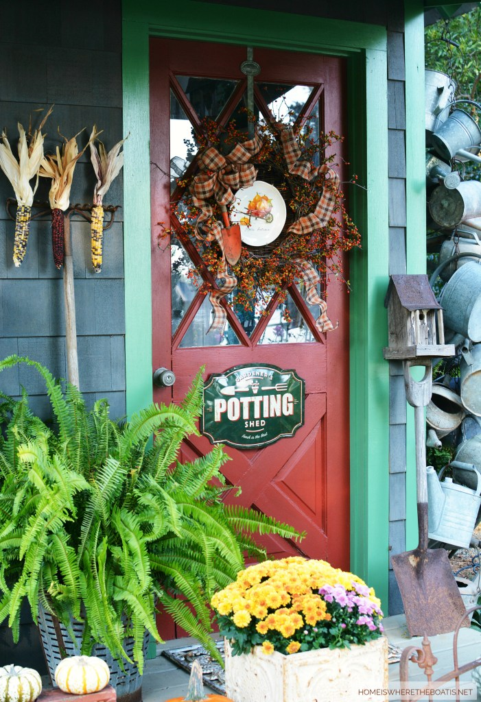 Hello Autumn Wreath Potting Shed Door | ©homeiswheretheboatis.net #fall #shed #mums