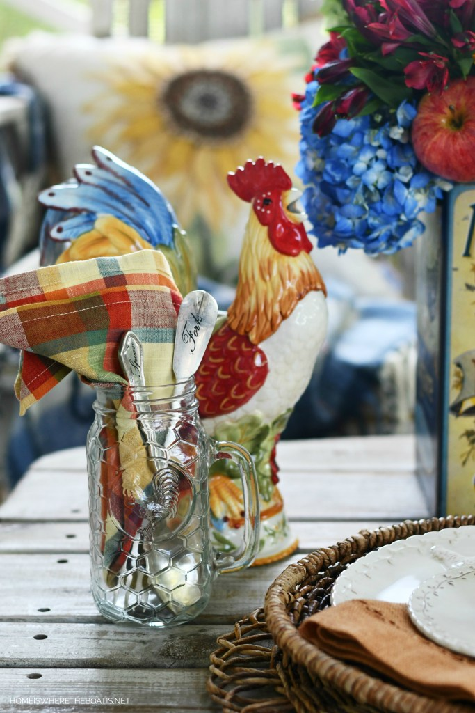 Roosters and sunflowers on the porch | ©homeiswheretheboatis.net #hydrangeas #sunflowers #rooster
