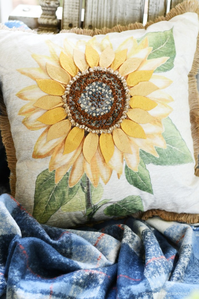 Sunflower pillow on porch | ©homeiswheretheboatis.net