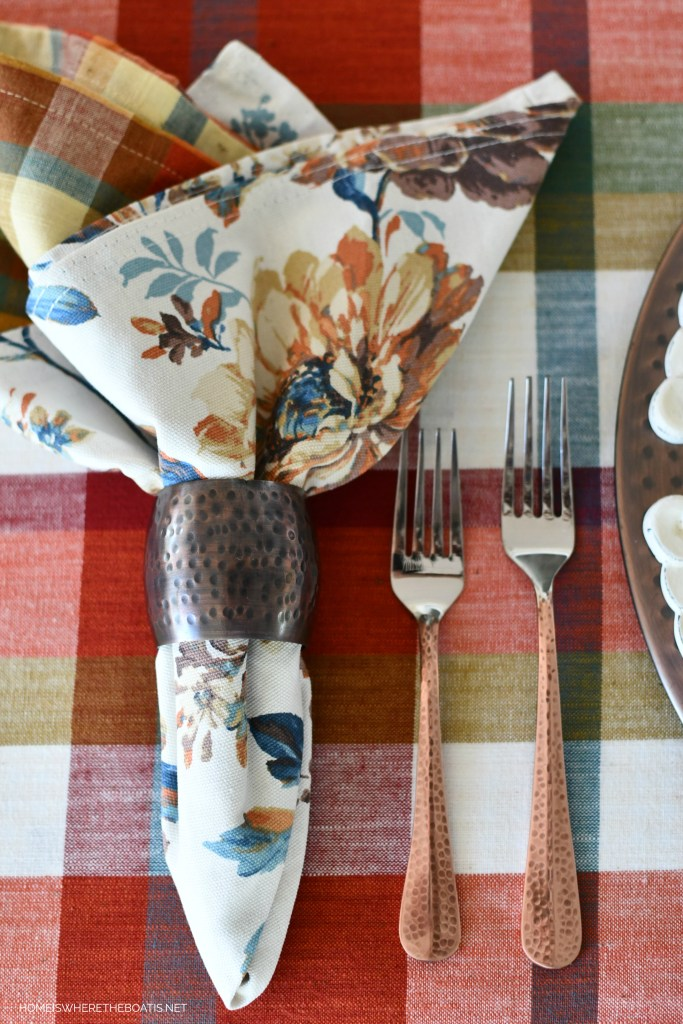 Copper flatware and napkin rings Transitional Fall Table | ©homeiswheretheboatis.net #fall #tablescapes #plaid