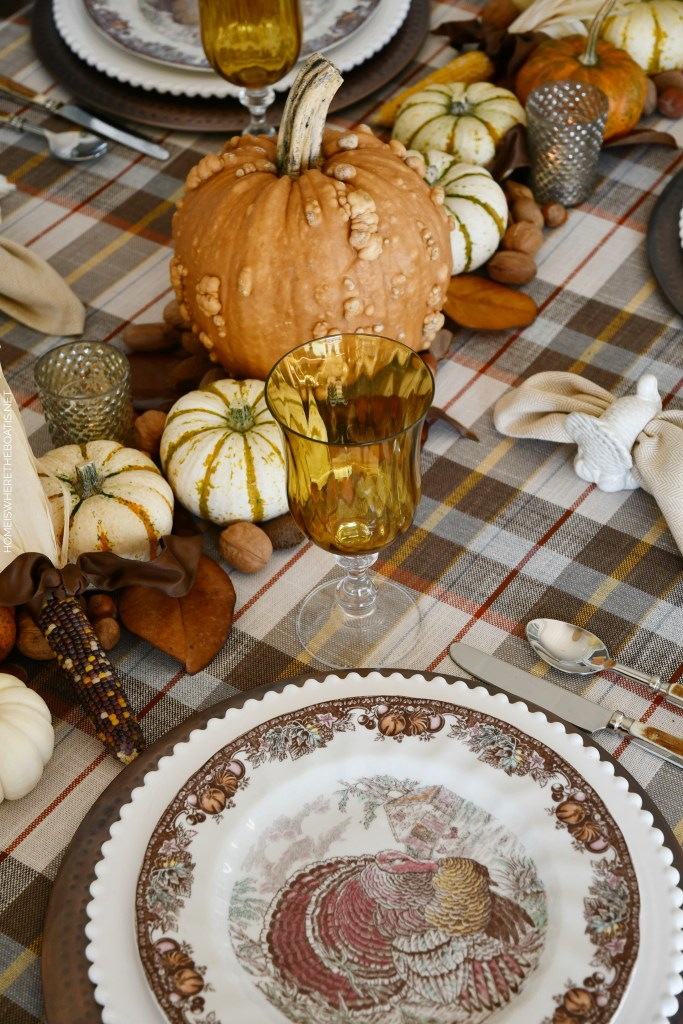 Thanksgiving table with plaid, natural runner with pumpkins and turkey plates | ©homeiswheretheboatis.net #thanksgiving #tablescapes #DIY