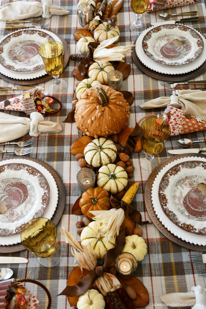 Giving Thanks Tablescape with pumpkin runner and Cone-ucopias | ©homeiswheretheboatis.net #thanksgiving #tablescapes #plaid