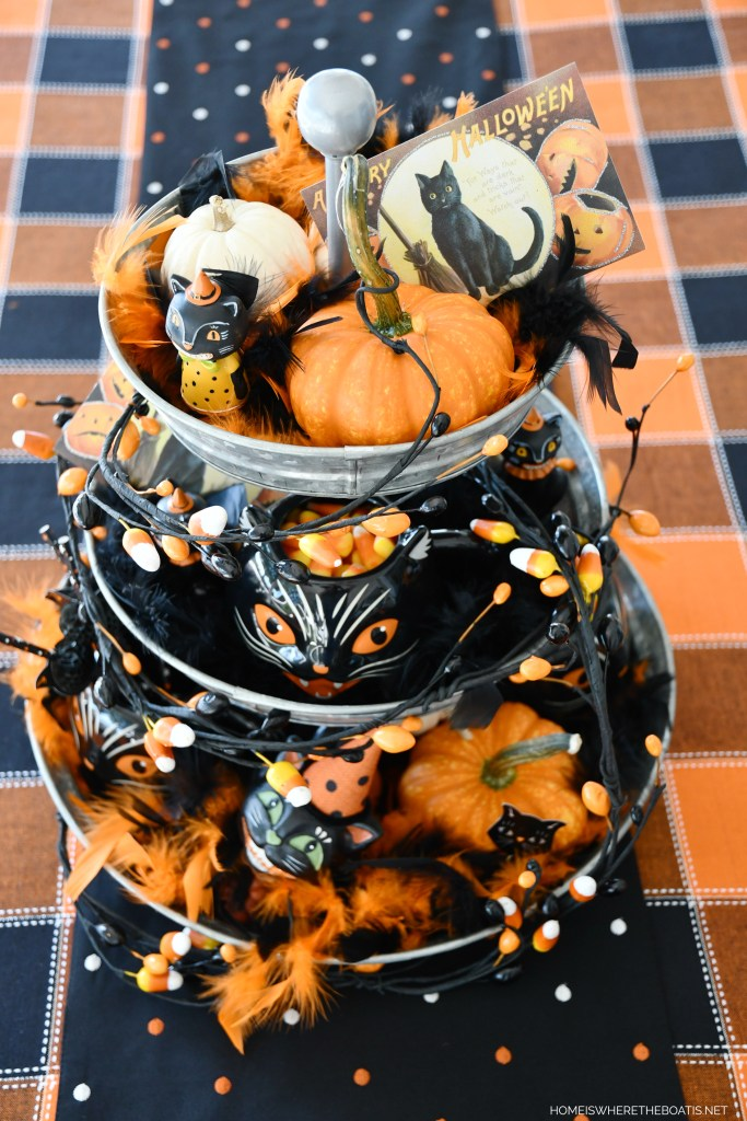 Halloween Black Cat table centerpiece with galvanized tiered tray | ©homeiswheretheboatis.net #halloween #tablescapes