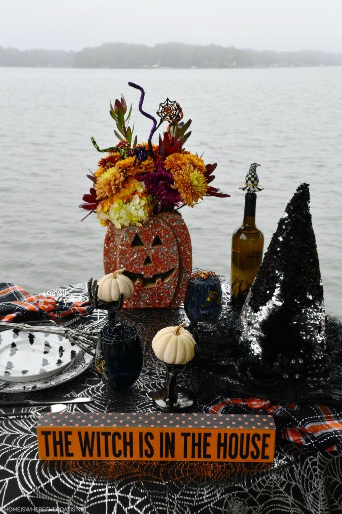Halloween tablescape by lake | ©homeiswheretheboatis.net #halloween #tablescape #skeleton