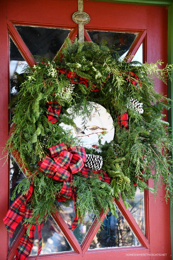 Christmas wreath with bird plate and tartan ribbon | ©homeiswheretheboatis.net #shed #christmas #wreath