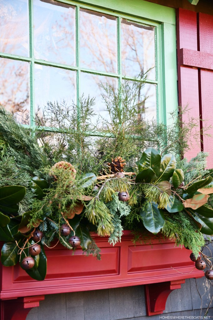 Potting Shed window boxes 'spruced up' for Christmas with greenery | ©homeiswheretheboatis.net #windowboxes #evergreens #christmas