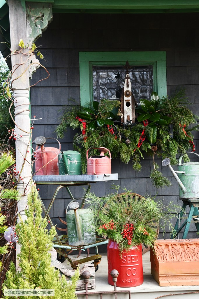 Potting Shed with birdhouse in window box with greenery for Christmas | ©homeiswheretheboatis.net #shed #christmas #greenery