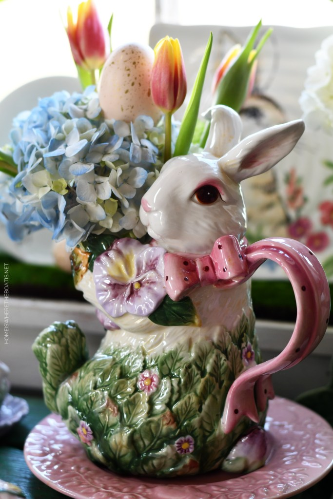 Bunny pitcher with hydrangeas, tulips and Easter egg | ©homeiswheretheboatis.net #spring #easter #tablescape #flowers #rabbits
