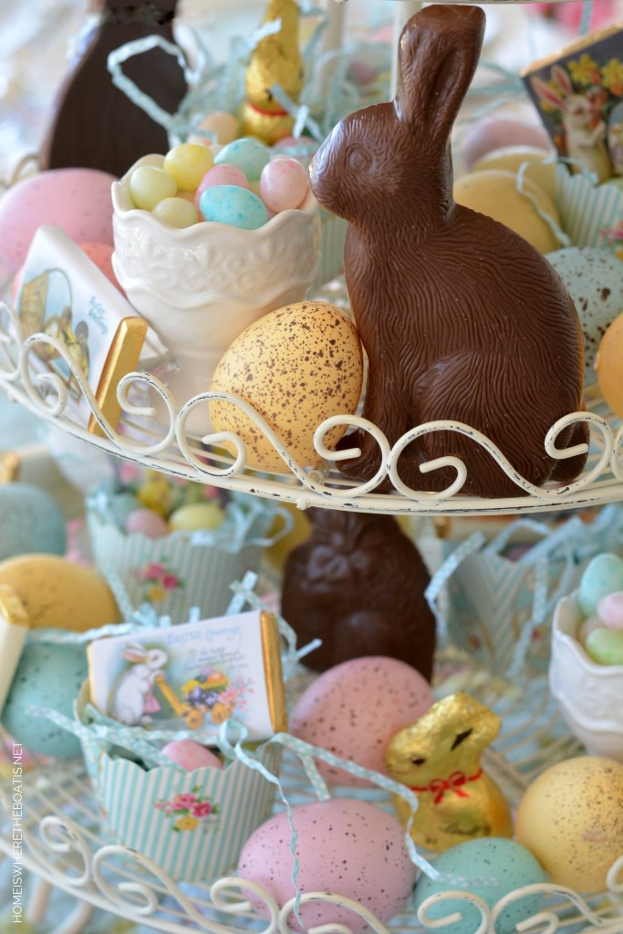 Easter table centerpiece with chocolate bunnies, jelly beans and eggs | ©homeiswheretheboatis.net #easter #tablescapes