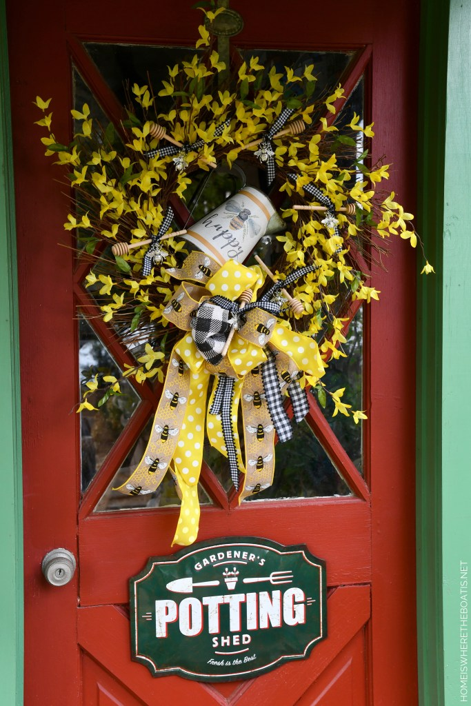 DIY 'Bee Happy' Wreath on Potting Shed door | ©homeiswheretheboatis.net #DIY #craft #wreath #bees #earthday
