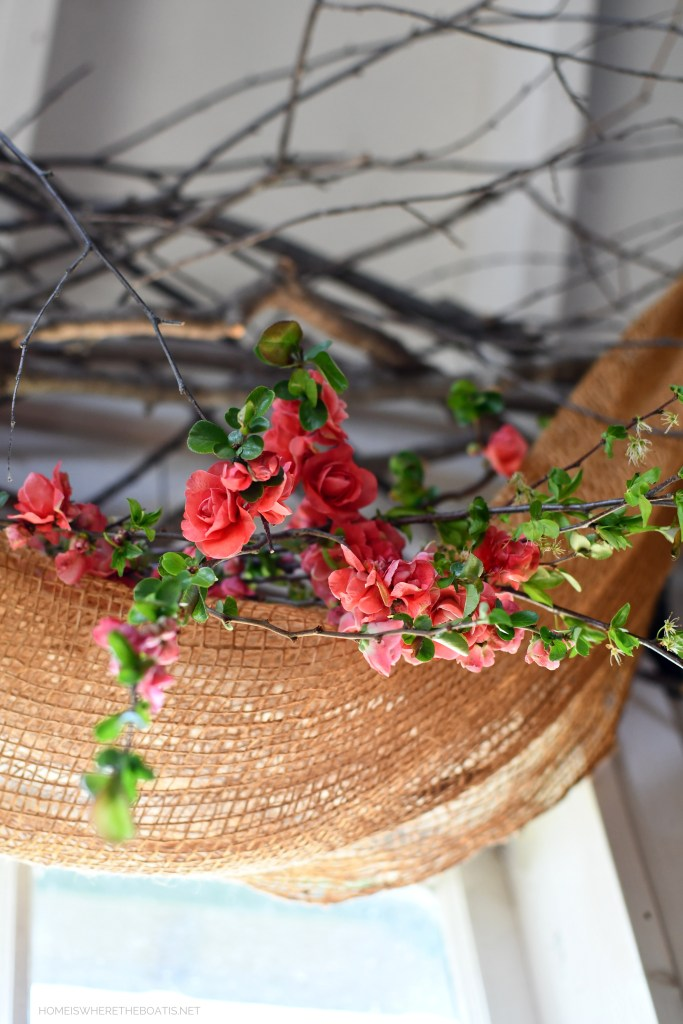Blooming quince branches in the Potting Shed | ©homeiswheretheboatis.net #shed #spring