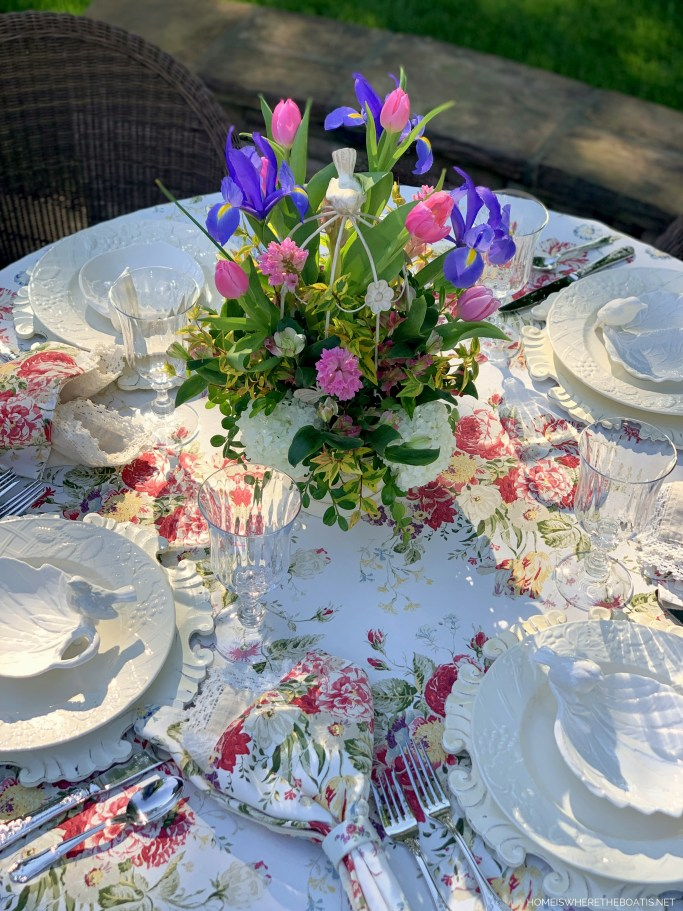 Spring Table with Decorative Bird Cage Floral Arrangement | ©homeiswheretheboatis.net #spring #flowers #diy #tablescape #alfresco
