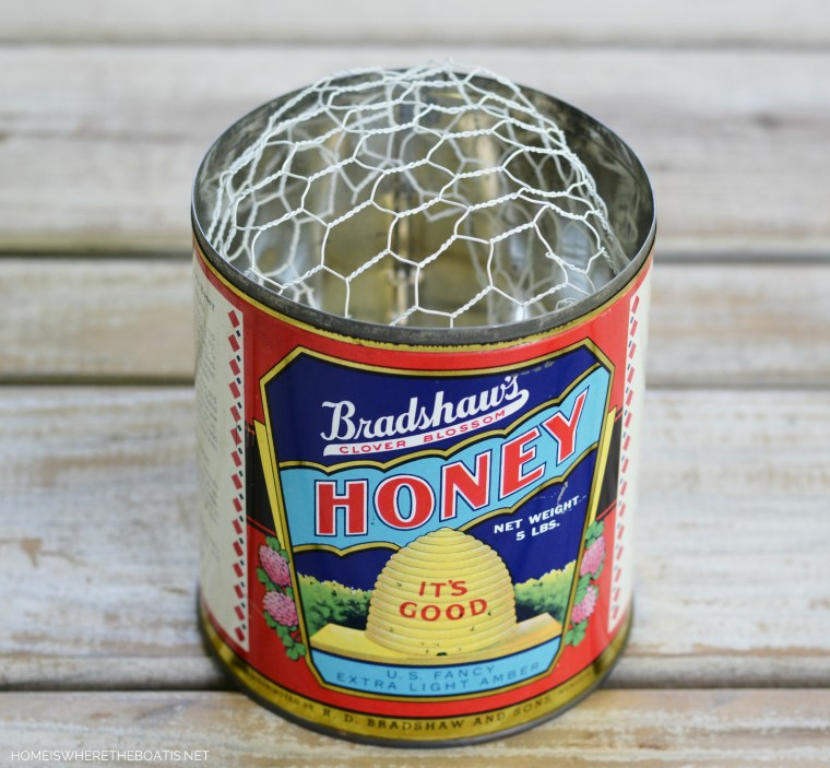 Bradshaw's Clover Blossom Honey tin as vase for flowers with chicken wire | ©homeiswheretheboatis.net #bees #tablescapes
