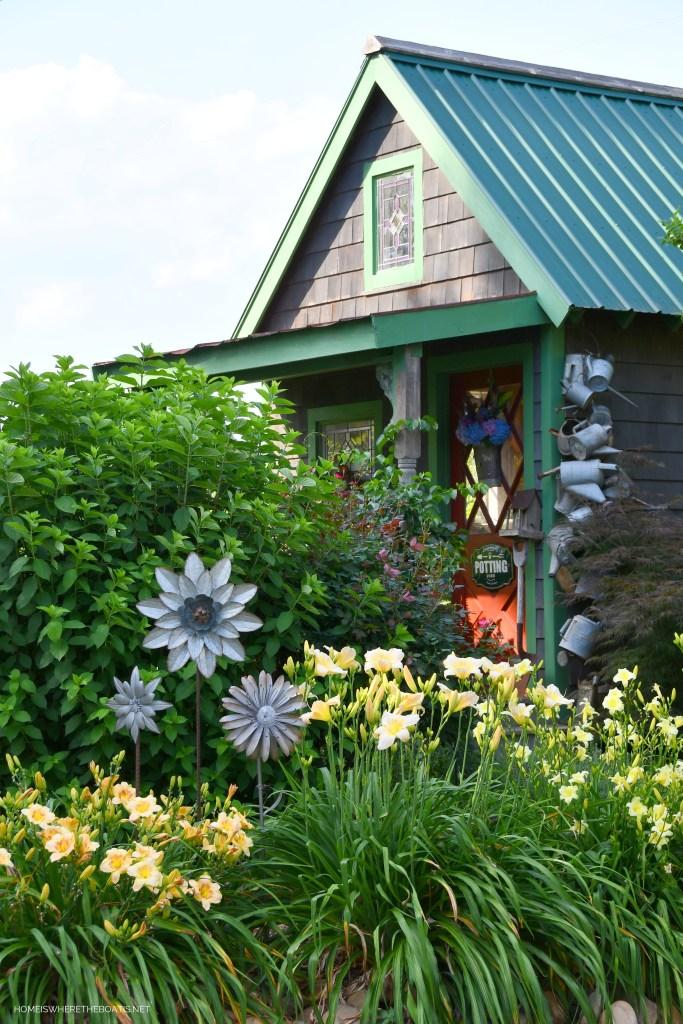 Bee door basket flower arrangement on Potting Shed door | ©homeiswheretheboatis.net #flowers #DIY #garden #bees #nationalpollinatorweek