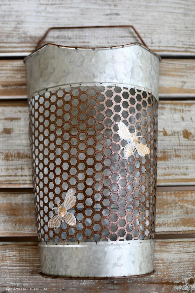 Galvanized bee door basket with honeycomb design | ©homeiswheretheboatis.net #flowers #DIY #garden #bees #nationalpollinatorweek
