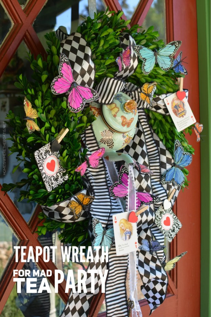 Teapot Wreath for a Mad Tea Party | ©homeiswheretheboatis.net #teaparty #aliceinwonderland #wreath #butterflies #tablescape