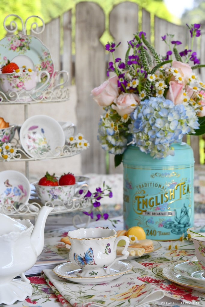 Tea on the porch and Tea Tin Flower Arrangement | ©homeiswheretheboatis.net #tea #flowerarrangement
