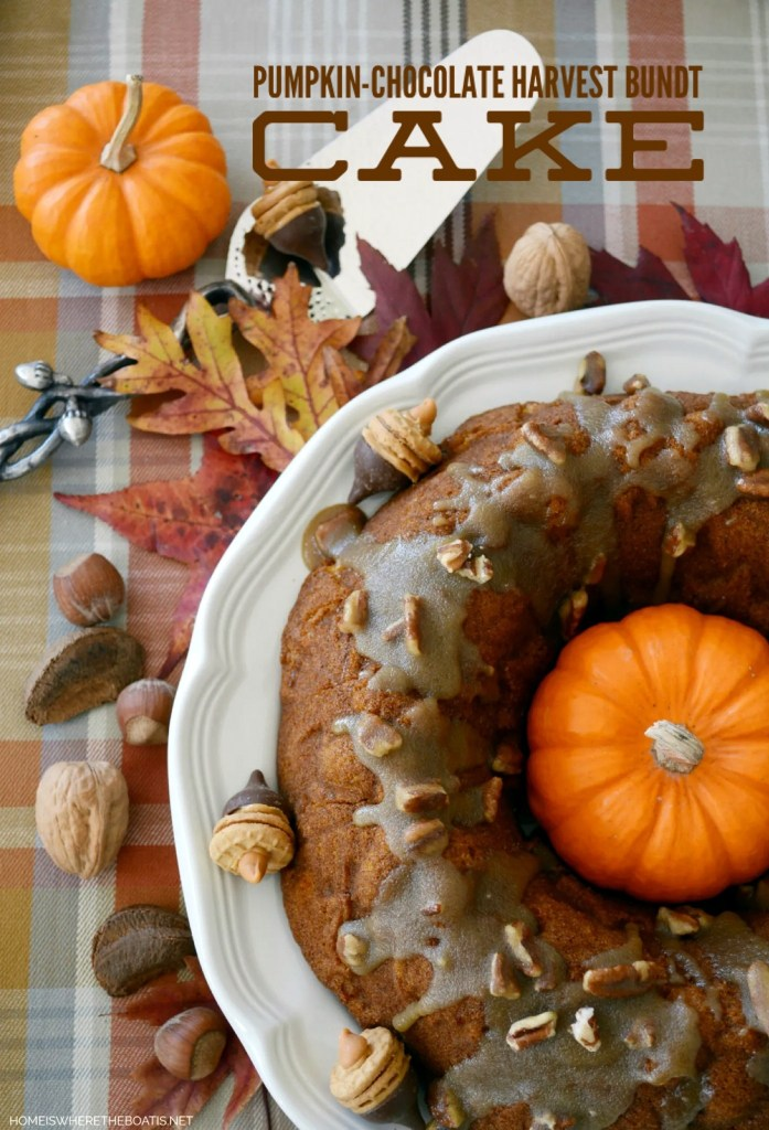 Pumpkin-Chocolate Harvest Cake with Bourbon-Pecan Glaze! Pumpkin meets chocolate and a Bourbon-Pecan Glaze. Serve it with some Nutter Butter and Hersey Kisses Acorns for a fun and season addition and nod to fall.