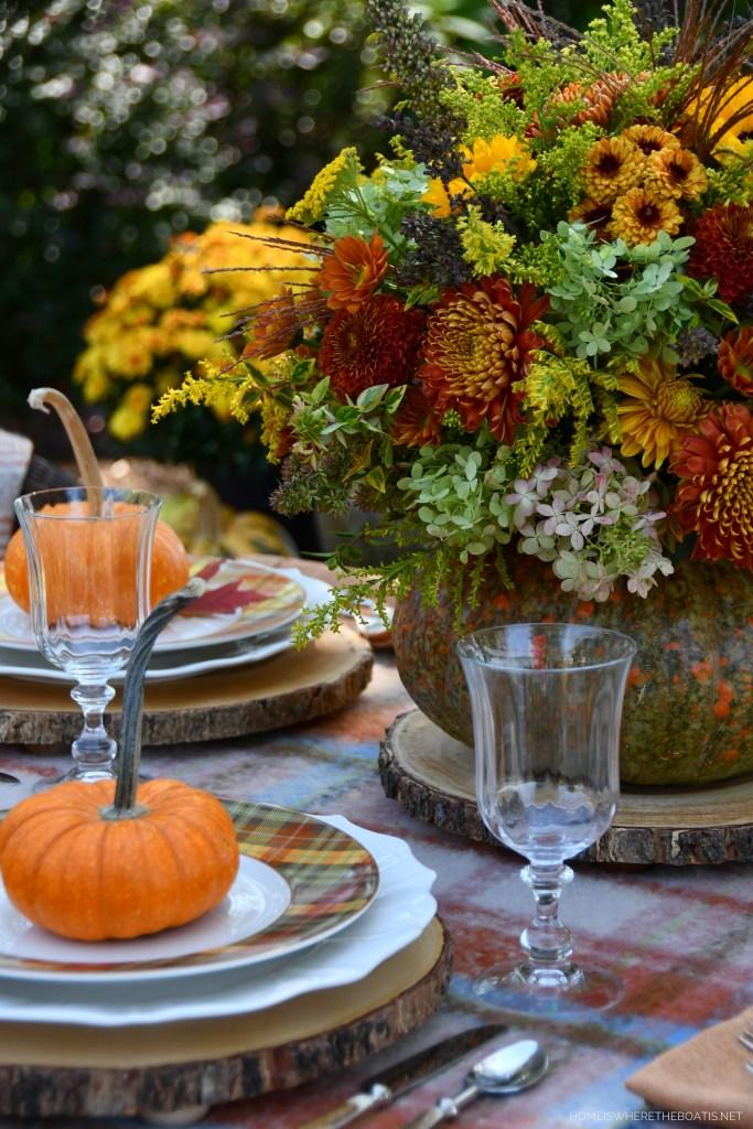 DIY Blooming Pumpkin Using a Shortcut + Alfresco Fall Table   ©homeiswheretheboatis.net #fall #pumpkin #flowerarrangement #DIY #alfresco #tablescape