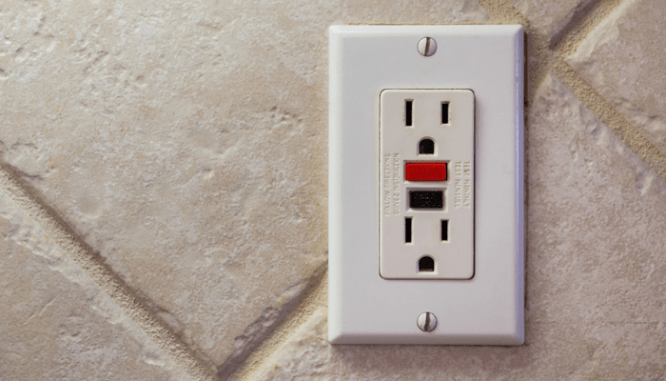 A GFCI outlet in a Riverside house for sale.