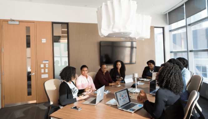 A group of sellers working with a real estate attorney in a conference room.